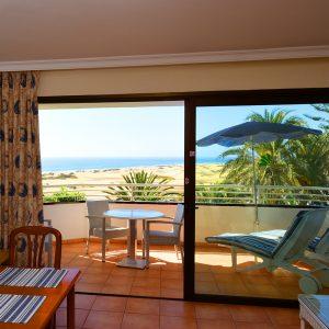 Von den Balkonen genießen Sie einen einzigartigen Blick auf die Dünen von Maspalomas und das Meer